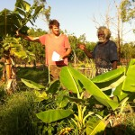 AHED Client Timothy Dhimala discusses his market garden enterprise with an AHED Facilitator