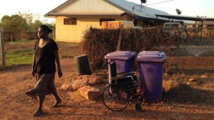 Dianne, leaves her wheel chair at the bins ready for the rubbish.